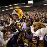 BATON ROUGE, LA - OCTOBER 25:  Members of the LSU Tigers celebrate their 10-7 win over Mississippi Rebels at Tiger Stadium on October 25, 2014 in Baton Rouge, Louisiana.  (Photo by Chris Graythen/Getty Images)