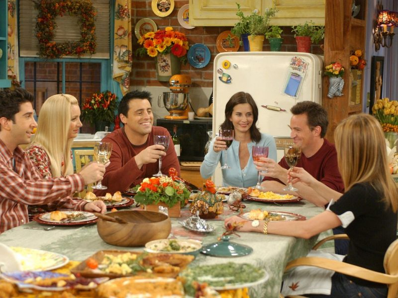 Cast of Friends around a table
