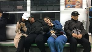 Students sitting on the subway