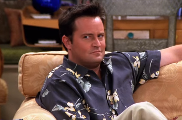 Chandler Bing from Friends sitting on the couch