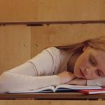 Girl asleep at a desk