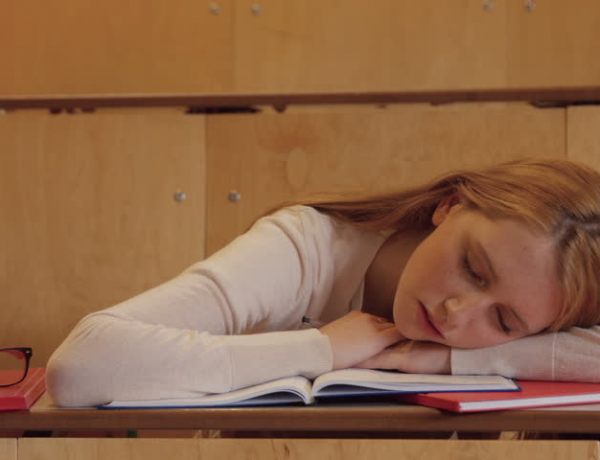 Girl asleep at a desk