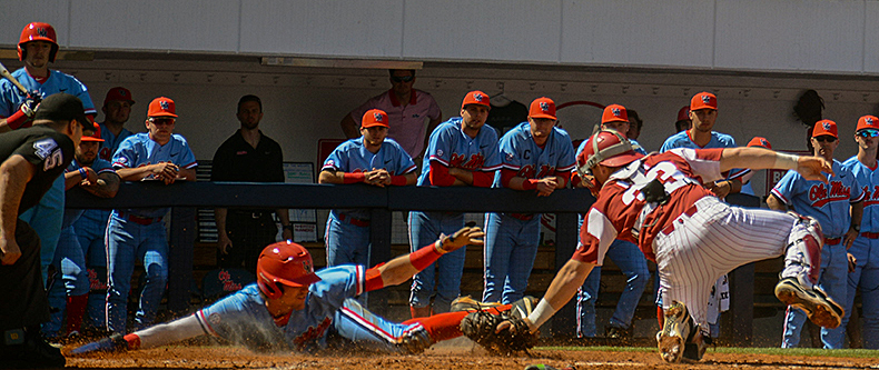 Ryan Olenek (2) slides into home plate during a game against Arkansas Saturday, March 31, 2018. Rebels won 11-10, winning the series 2-1. Photo by Tucker Robbins.